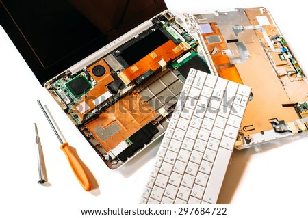 Repair set of the disassembled broken computer (laptop). The isolated image on a white background - stock photo