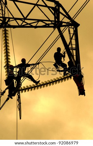 repairing a power line - stock photo