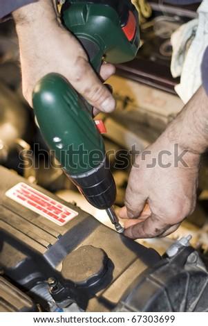 Repairing machinery - Engine of a vehicle - stock photo
