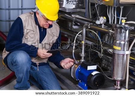 repairman at maintenance work - stock photo