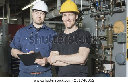 repairman engineer or inspector who check the system. - stock photo