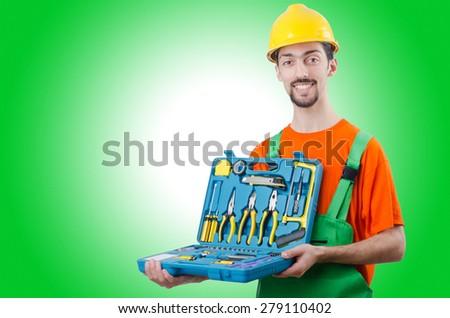 Repairman in coveralls in industrial concept - stock photo