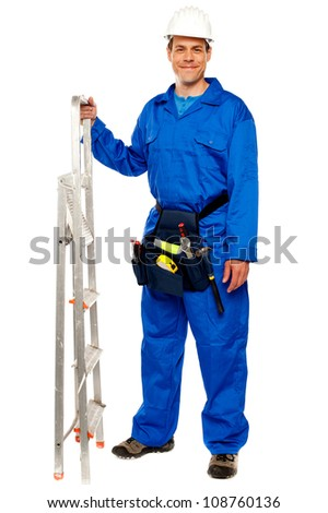Repairman with a stepladder and tools bag standing against white background - stock photo