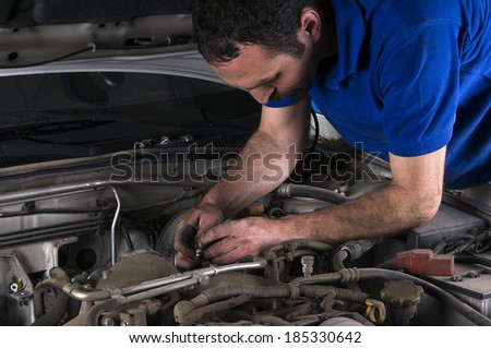 Repairman Working at Auto Repair Shop