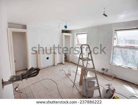 Repairs in the apartment. Wallpapering in the room. - stock photo