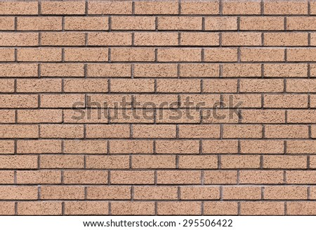 Repeating red brick wall texture typically found in developed areas, often around the backs of buildings in cities. The file is a loop ready seamless texture file allowing the picture to be tiled. - stock photo