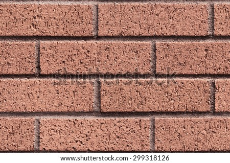 Repeating sandy brick wall texture typically found in developed areas, often seen around the backs of buildings. The file is a loop ready seamless texture file, allowing the picture to be tiled. - stock photo