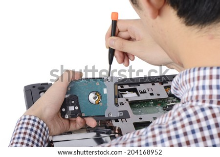 replacing a laptop hard disk drive on a white background - stock photo
