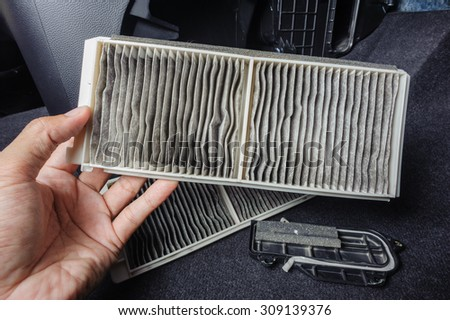 replacing cabin air conditioner filter of car - stock photo