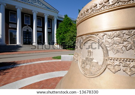 Replica of Centennial Bell in front of Baker Library at Harvard Business School (the original is in cupola on top of the building) - stock photo