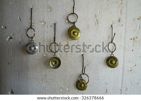 Replica of traditional gongs for sale on display during Sunday market at the village in Kudat Sabah, Borneo, Malaysia - stock photo