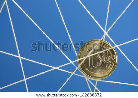 representation of the economic crisis held in a web - stock photo