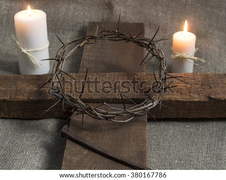 Representation of the Jesus Christ crown of thorns, cross, candles and nail. - stock photo
