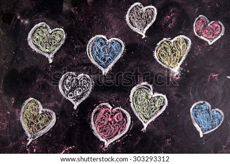 Representation with chalk on blackboard series of colorful hearts - stock photo