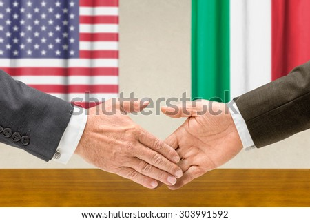 Representatives of the USA and Italy shake hands - stock photo