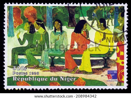 REPUBLIC NIGER - CIRCA 1998: A stamp printed in Niger shows painting by Paul Gauguin, Ta Matete Aka the Market, series, circa 1998 - stock photo