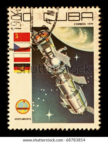 REPUBLIC OF CUBA - CIRCA 1979: A vintage postal stamp printed in Cuba with a postmark dated 1904, depicting a space satellite named Acoplamiento in orbit circa 1979 - stock photo