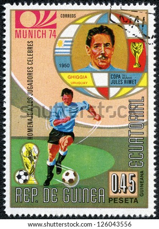 REPUBLIC OF EQUATORIAL GUINEA - CIRCA 1974: A stamp printed in the Republic of Equatorial Guinea shows football player (Champions Cup : Munich, Germany) and portrait Copa Jules Rimet, circa 1974. - stock photo