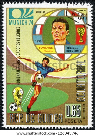 REPUBLIC OF EQUATORIAL GUINEA - CIRCA 1974: A stamp printed in the Republic of Equatorial Guinea shows football player (Champions Cup : Munich, Germany) and portrait Fontaine(France), circa 1974. - stock photo
