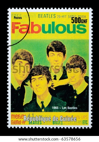 REPUBLIC OF GUINEA - CIRCA 2001: A postage stamp printed in Guinea showing  The Beatles, circa 2001 - stock photo