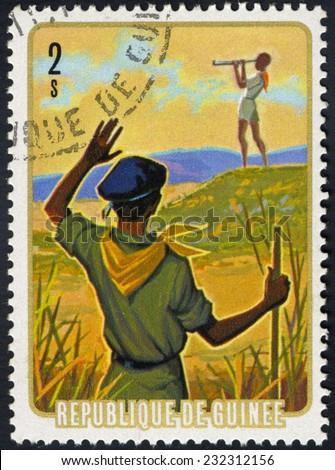 REPUBLIC OF GUINEA - CIRCA 1974: A stamp printed in Republic of Guinea, shows Field observation, circa 1974 - stock photo