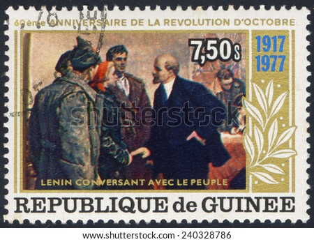 REPUBLIC OF GUINEA - CIRCA 1977: A stamp printed in Republic of Guinea, shows 60 years of Great October Revolution, Lenin and revolutionary, a collection, circa 1977 - stock photo
