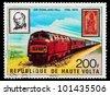 REPUBLIC OF UPPER VOLTA, BURKINA FASO - CIRCA 1979: A stamp printed in Republic of Upper Volta shows portrait of sir Rowland Hill and train, circa 1979 - stock photo