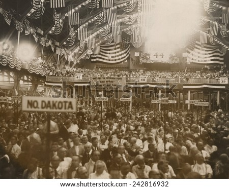Republican Convention in Chicago, June 1920. In the background, a National Women's Party banner reads, 'Why does the Republican Party Block suffrage?' Tennessee legislature became the 36th state. - stock photo