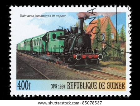 REPUBLIQUE DE GUINEE - CIRCA 1999 : A stamp printed in Republique de Guinee shows a train, series, Train avec locomotives de vapeur, circa 1999