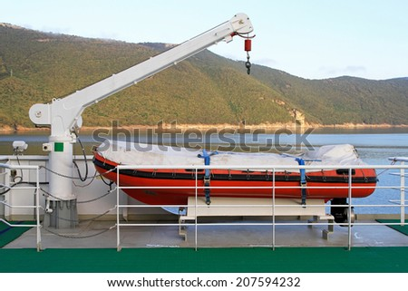 Rescue boat with crane at car ferry - stock photo