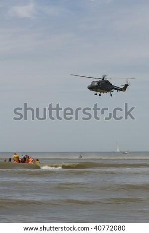Rescue event 2009 in Holland. Lynx helicopter hoist a drowned victem.