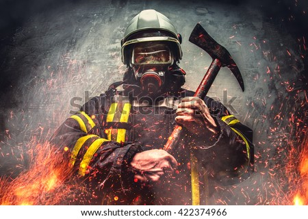 Rescue firefighter man in a fire holds iron axe.