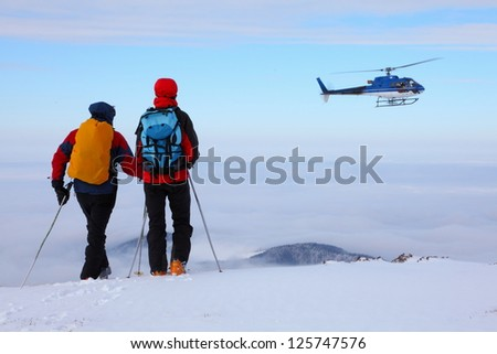 Rescue helicopter and rescue party, Tarcu mountains, Romania - stock photo