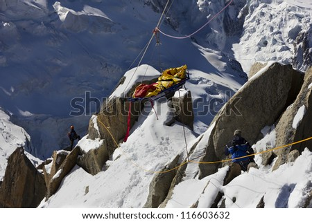 Rescue team in montain - stock photo