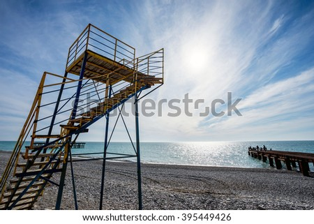 Rescue tower on beach on background beautiful seascape in summer season - stock photo