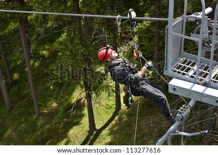 rescuer on the rope, exercise special police units, the real situation, the Czech Republic, lift skiing resort Klinovec - stock photo