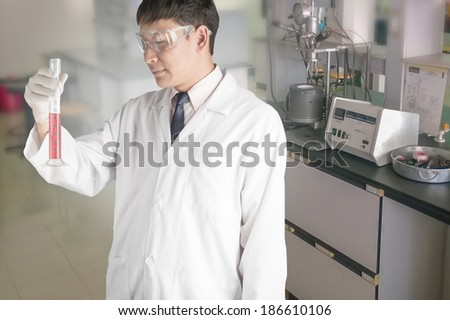 Research and test tubes in the laboratory.  - stock photo