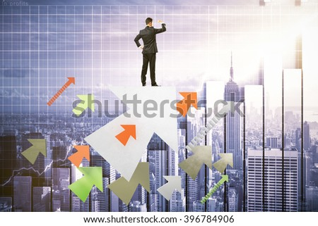 Research concept with businessman standing on colorful arrows, looking into the distance on digital city background - stock photo