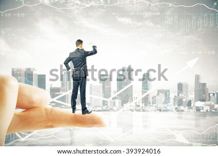 Research concept with businessman standing on finger tip, looking into the distance on digital city background - stock photo