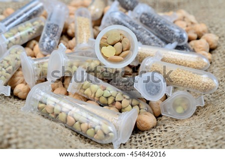 research grain in tube on sack - stock photo