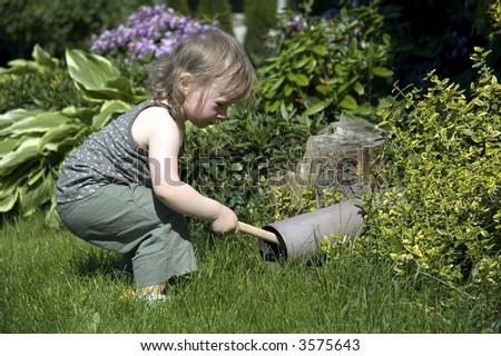 research kid. sweet girl in garden - stock photo