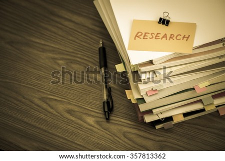 Research; The Pile of Business Documents on the Desk - stock photo