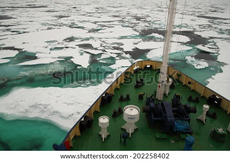 Research vessel in icy arctic sea - stock photo