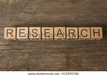 RESEARCH word on wooden cubes - stock photo