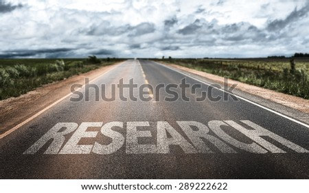 Research written on rural road - stock photo