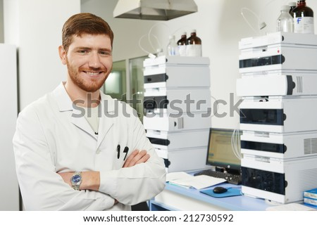 researcher man at scientific analysing work in chemistry laboratory - stock photo