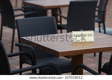 Reservation Card on a Table in the rain - stock photo