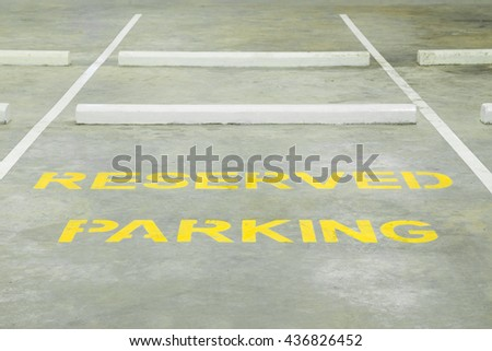 Reserved parking lot for mobility or disable people hilighten in yellow color - stock photo