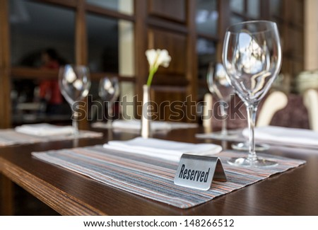 Reserved table sign in a restaurant - stock photo