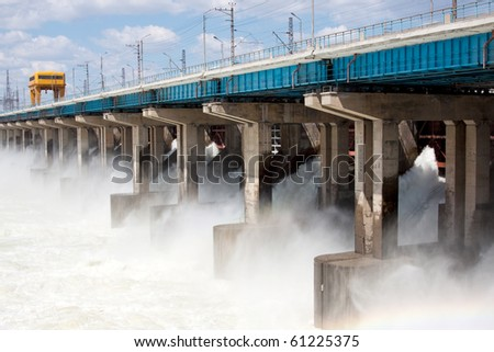 Reset of water on hydroelectric power station on the river - stock photo